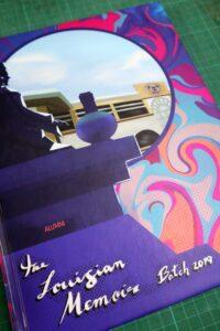 The Louisian Memoir Yearbook #vjgraphicsprinting #growthroughprint #offsetprinting #yearbook — with Saint Louis College of San Fernando, La Union