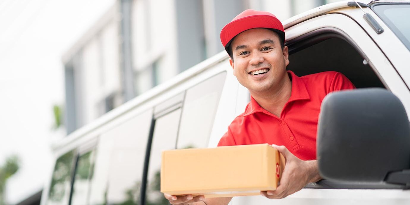 young-delivery-man-red-uniform-driving-truck-sending-parcel